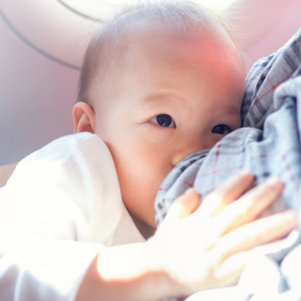 Is it all right to feed my baby when he has a blocked nose?